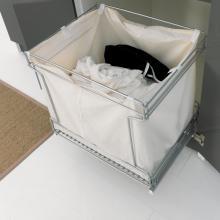 Wäschesäule mit zwei Türen, ausziehbarem Tisch und Wäschekorb Colf